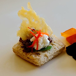 Parmesan wafer, olive tapenade and goat cheese crostini square thumbnail