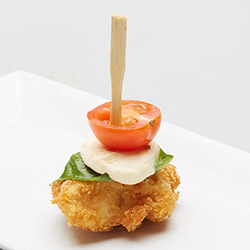 Chicken parmigiana with bocconcini, fresh basil leaf and cherry tomato thumbnail