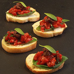 Bruschetta with basil, roasted capsicum and olive tapenade thumbnail