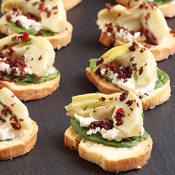 Marinated artichoke and goat cheese on toast thumbnail