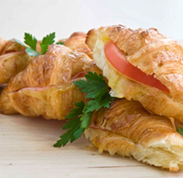 Savoury croissant filled with tasty cheese and tomato thumbnail