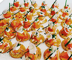 Smoked salmon and cream cheese on a cracker thumbnail