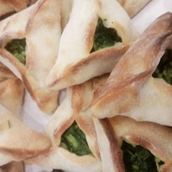 Spinach and halloumi cheese triangles thumbnail