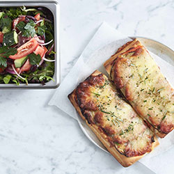 Pizza slice with our village salad thumbnail