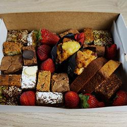 Mixed sweet treats and fruit garnish platter thumbnail