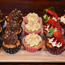 Assorted fruit and chocolate muffins thumbnail