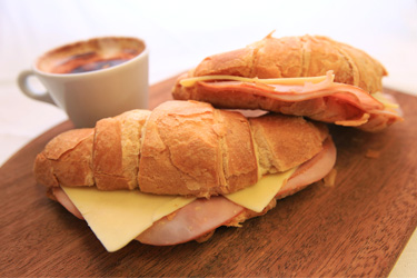 Croissant baked with cheese and ham thumbnail