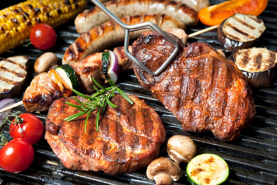 meat and vegetables on BBQ