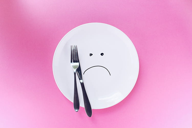 an empty plate without corporate catering